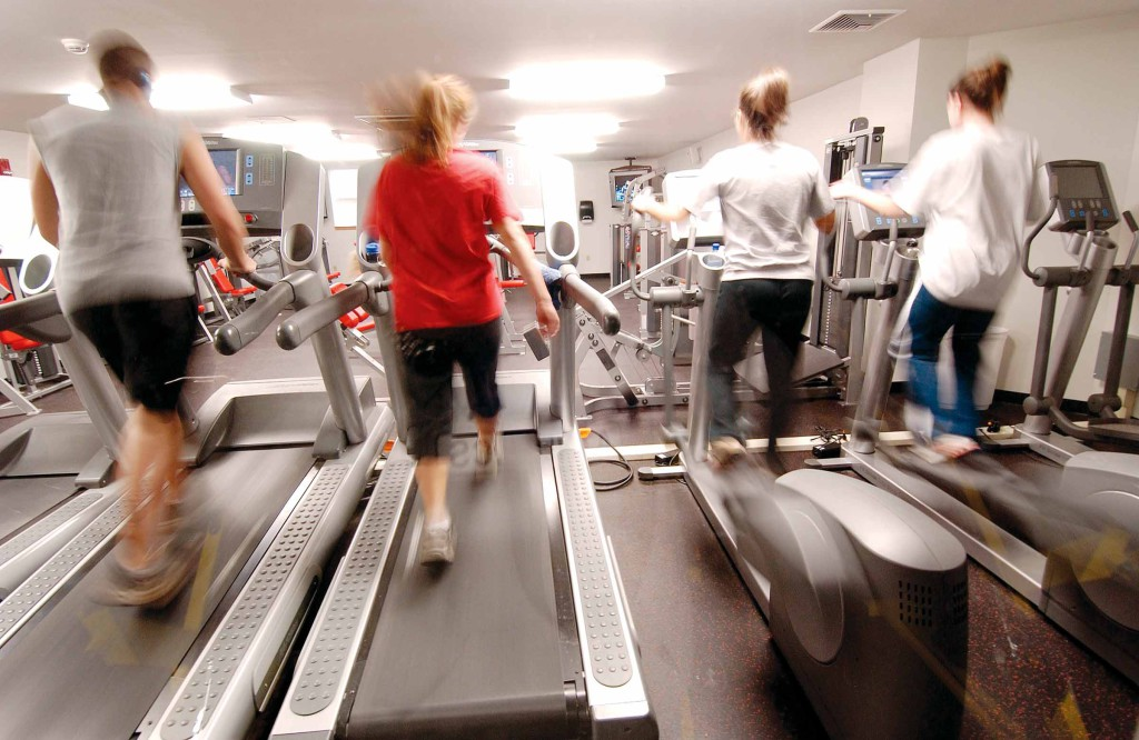 Students exercising on the treadmills in Christian Witness Commons Donovan Hall