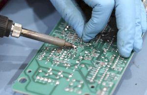 A range oven circuit board is soldered, Thursday, Feb. 2, 2012 in Glendale Heights. CoreCentric Solutions is a company that remanufactures electronics, appliances and appliance parts are no longer available from the original manufacturer. (Chuck Berman/ Chicago Tribune) B581855777Z.1 ....OUTSIDE TRIBUNE CO.- NO MAGS, NO SALES, NO INTERNET, NO TV, NEW YORK TIMES OUT, CHICAGO OUT, NO DIGITAL MANIPULATION...